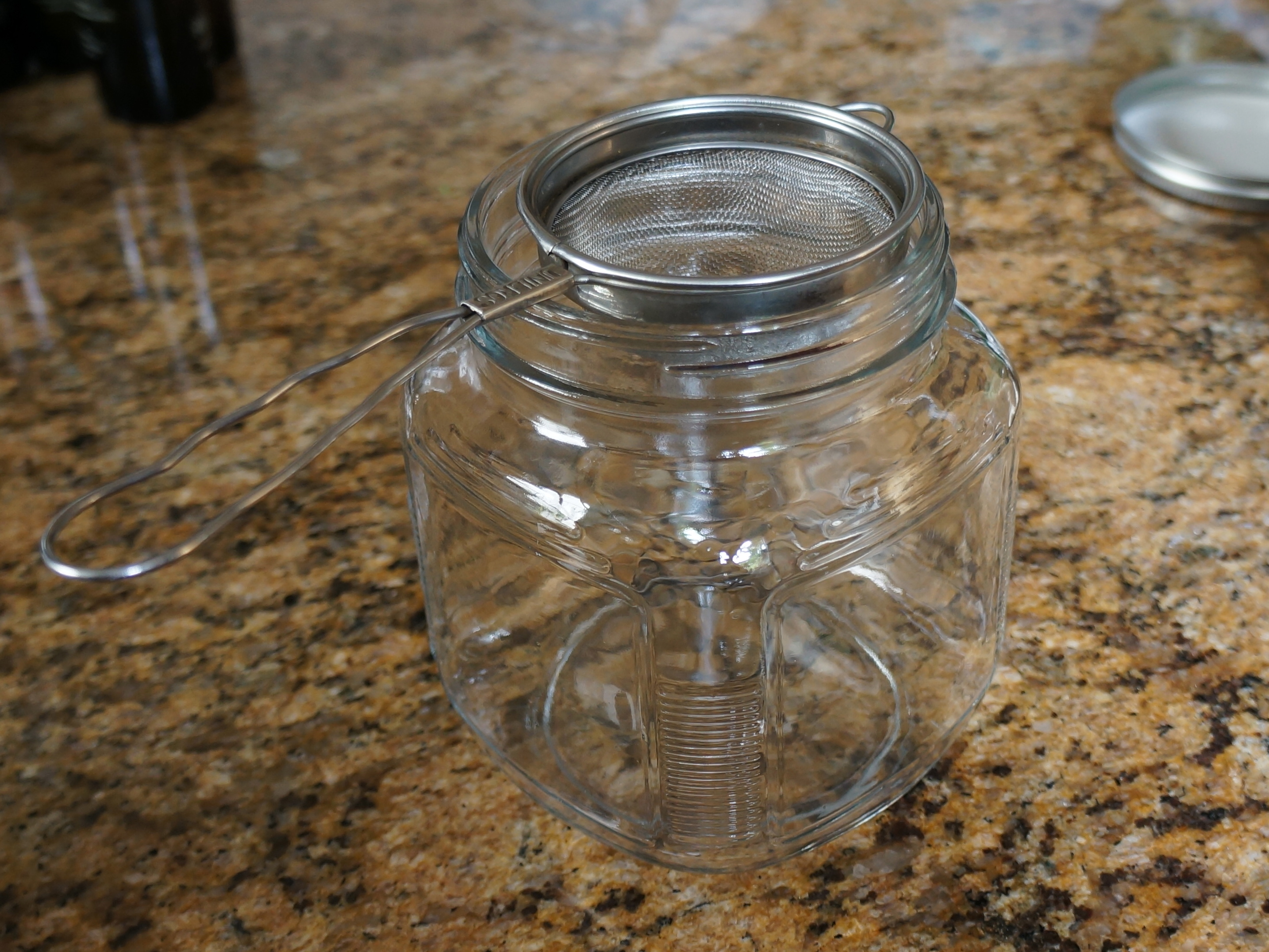 My glass jar and metal strainer