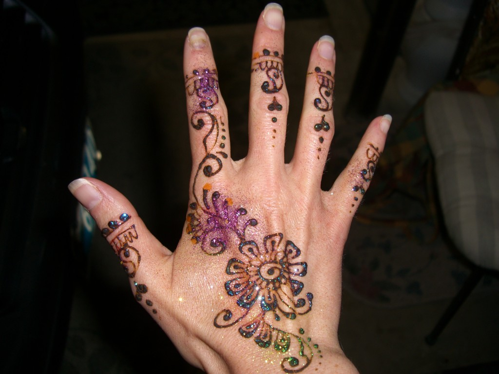 My hand freshly decorated with henna (and glitter!)