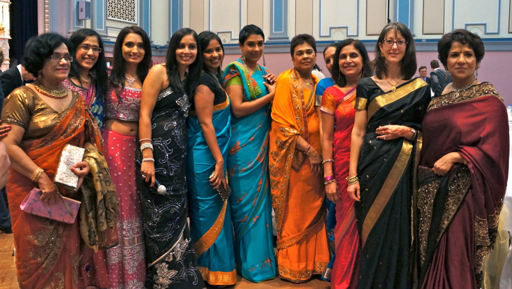 A lineup of family members at a wedding. My mother-in-law is in the burgundy sari on the far right.